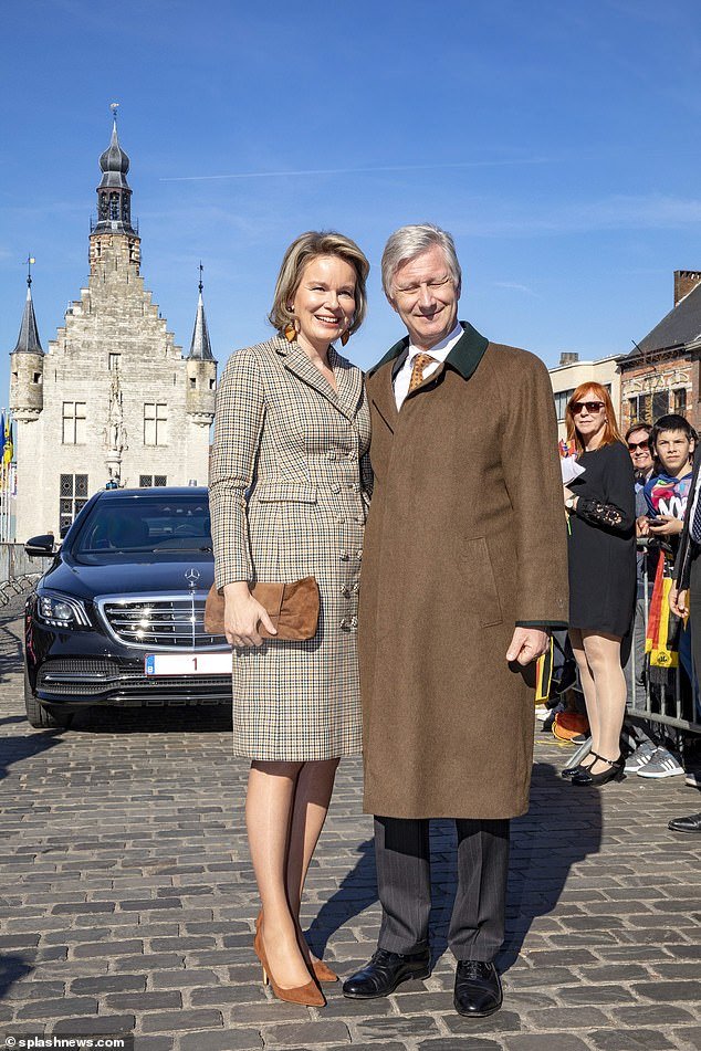 Queen Mathilde of Belgium looked elegant in a tweed ensemble as she joined KingPhilippe to bask in the Belgian sun during a visit toHerentals, Antwerp on Tuesday