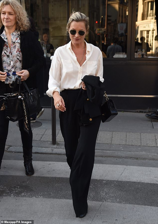 Stepping out: Kate Moss, 45, and her boyfriend Count Nikolai von Bismarck, 31, were spotted making some time for some retail therapy on Tuesday, hitting the designer boutiques together