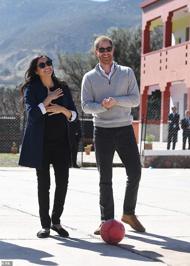 As they spoke to staff in the educational facility, Harry jokingly pretended he was unaware that his wife - who is due at the end of April - is expecting