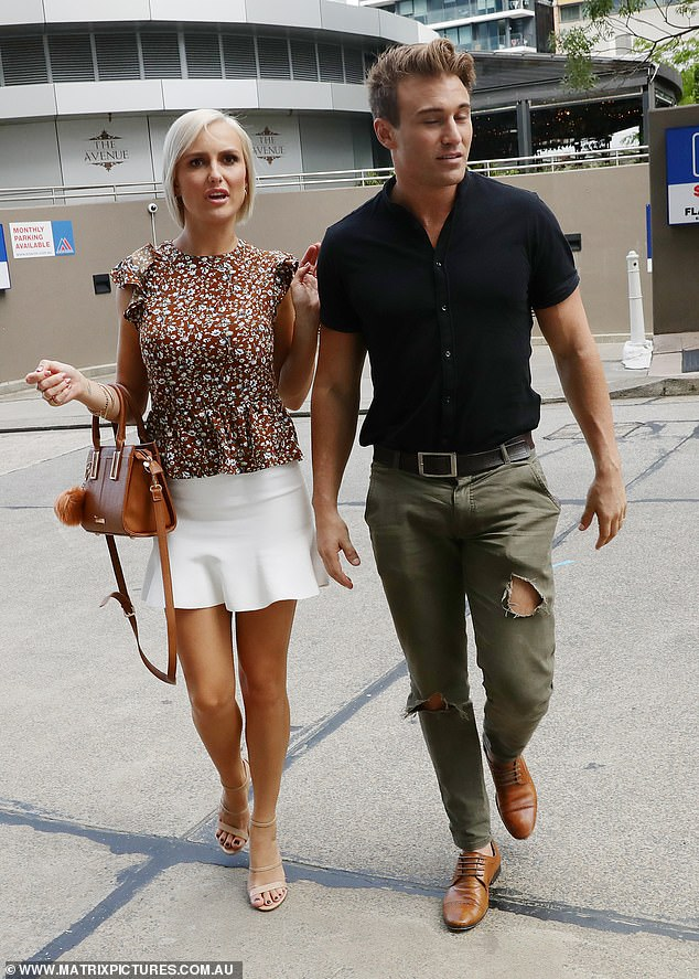 Casual: Meanwhile, personal trainer and model Billy looked smart in dark ripped trousers and a black polo T-shirt, which he teamed with tan leather shoes and a belt