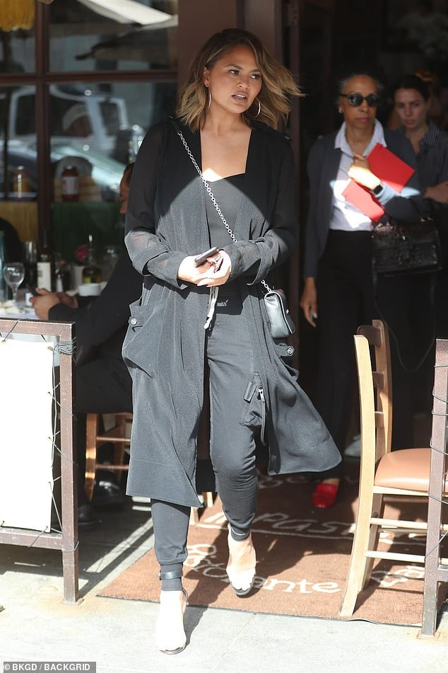 No reservations: Chrissy Teigen was sure to enjoy the cuisine at one of the hottest Italian restaurants in town as she left Il Pastaio in Beverly Hills on Tuesday afternoon
