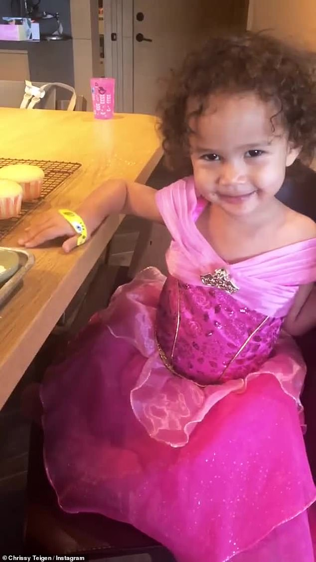Adorable: Later in the day, the ladies were back in the kitchen for a fashionable round of desserts with little Luna decked out in a pink princess gown