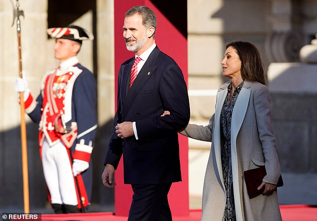 For the occasion, King Felipe (left) wore a suave double-breasted suit paired with a red and white striped tie