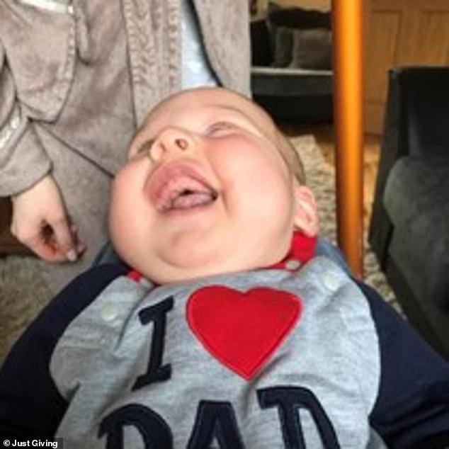 Staff at Wythenshawe Hospital describe Haris as a 'happy, smiley, friendly' baby