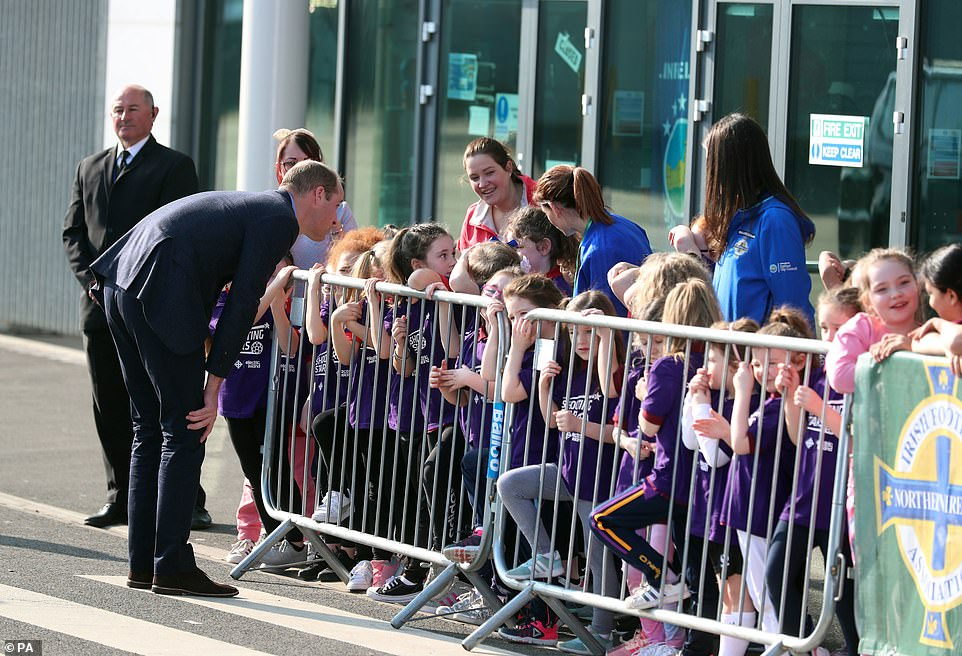 Father-of-three William bent down to speak to some of the children waiting outside Windsor Park for the couple, pictured
