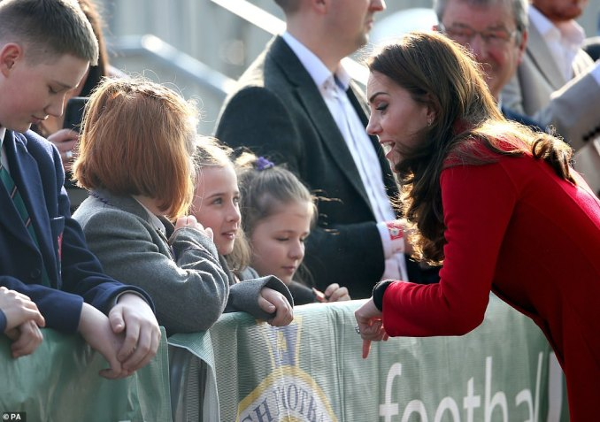 A group of young schoolgirls looked in awe of the Duchess of Cambridge, 37, as she leaned down to speak to them