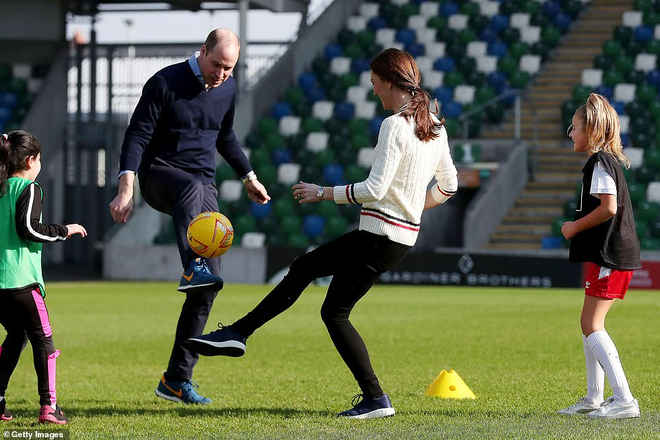 The Duke and Duchess of Cambridge went head-to-head as they joined youngsters for a game of football at Windsor Park