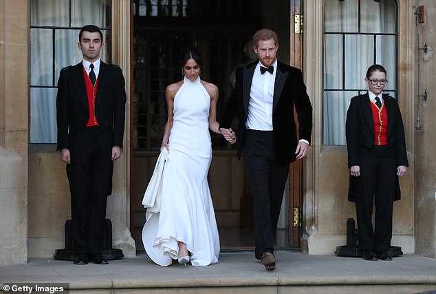 Daniel said that he gave Meghan a darker look for her second dress, to match the evening theme (the bride and groom are pictured leaving Windsor Castle to head to Frogmore House)