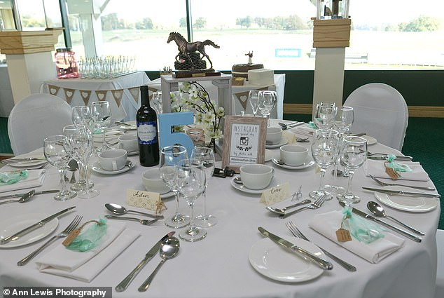 They decorated the venue themselves, which photo frames bought from The Range, and flowers from Home Bargains