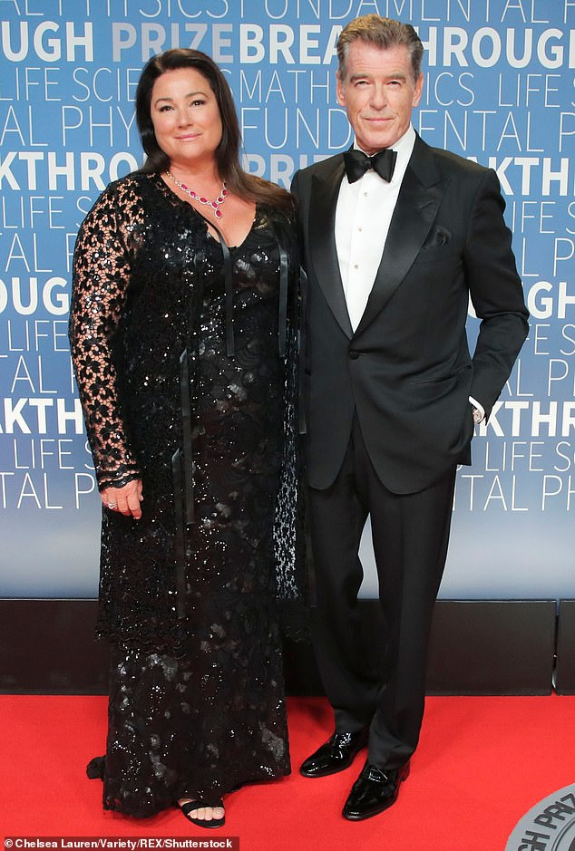 Love: Pierce appeared to be without his wife Keely Shaye Smith, who he has been together with for 25 years