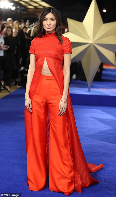 Leading ladies: Brie Larson and her co-star Gemma Chan channelled Captain Marvel's colour scheme for the sci-fi flick's London premiere, held at The Curzon Mayfair on Wednesday