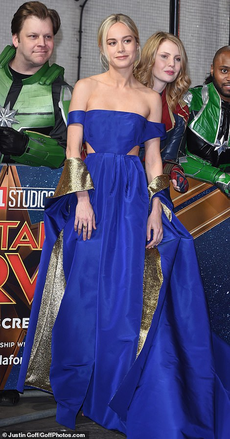 Blue-tiful! Brie, who plays the titular role in the eagerly-anticipatedmovie, stunned in a sweeping royal blue ball gown which boasted a modern edge with its sexy cut-outs at the sides and glittering gold draping