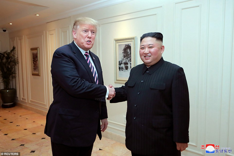 Summit day two: North Korea released this picture of Trump shaking hands with dictator Kim Jong Un on the first day of their talks in Hanoi, Vietnam, on Wednesday