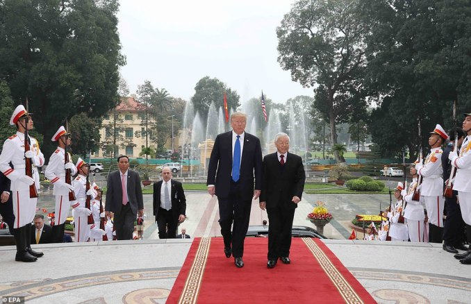 Trump review the guard of honor during a meeting with Vietnamese President Nguyen Phu Trong ahead of the US-North Korea summit in Hanoi