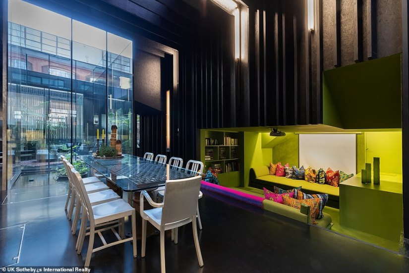 The sunken seating area, next to Lost House's dining room. One of Lost House's early owner painted this lounging space in neon green, and its next owner decided to stick with it