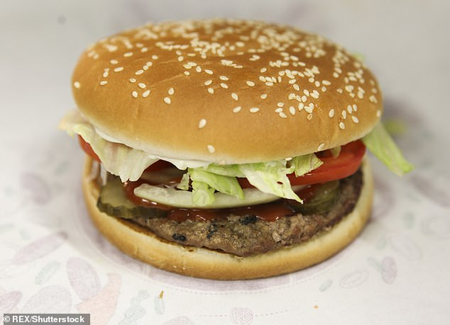 The amount of sodium also increased per decade by about 14 percent in entrées. Pictured: Whopper burger at a Burger King fast food restaurant
