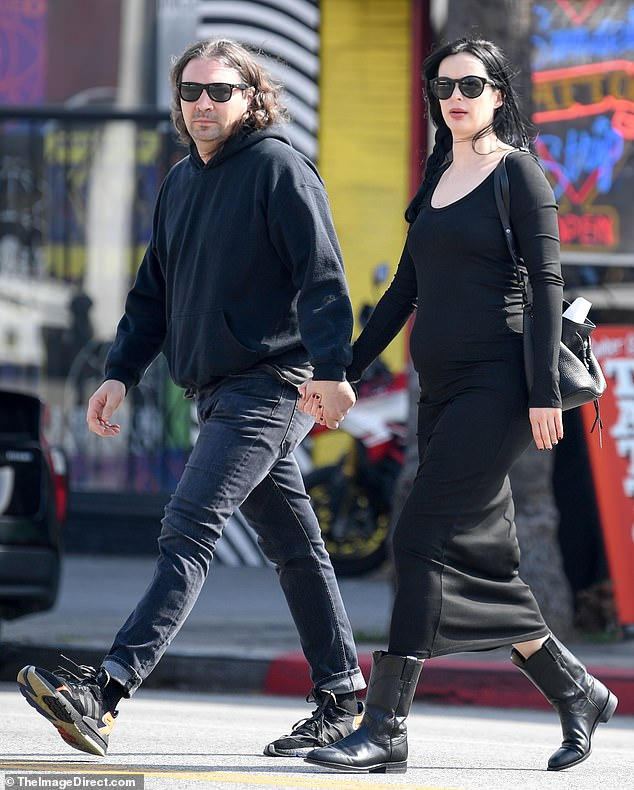 Bumping along: Krysten Ritter kept things simple in a black dress while out and about with boyfriend Adam Granduciel in Los Angeles on Wednesday