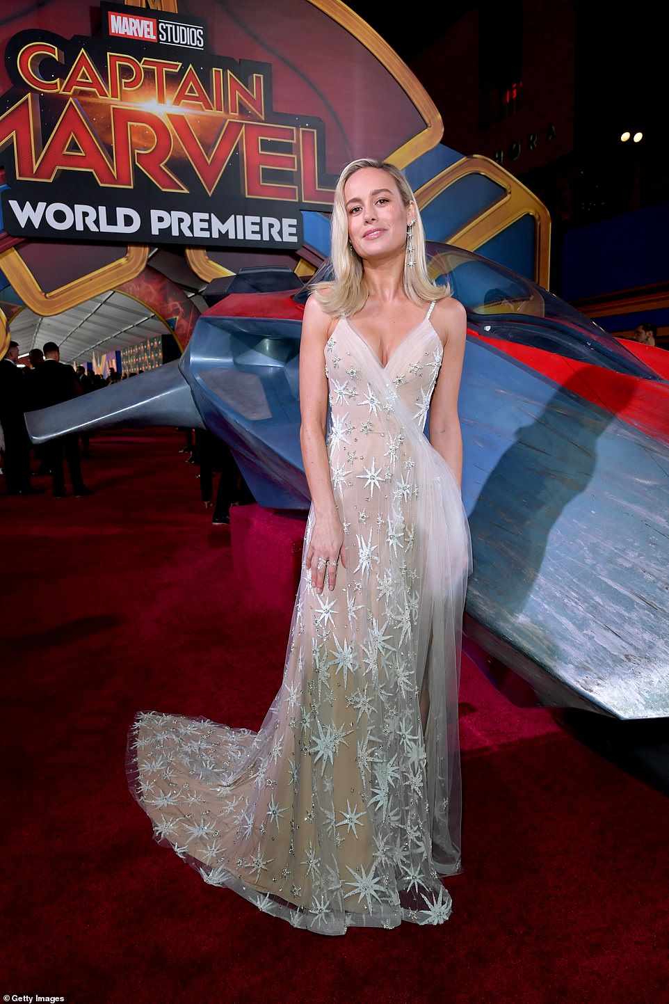 brie larson sparkles in jaw-dropping gold designer gown dotted with