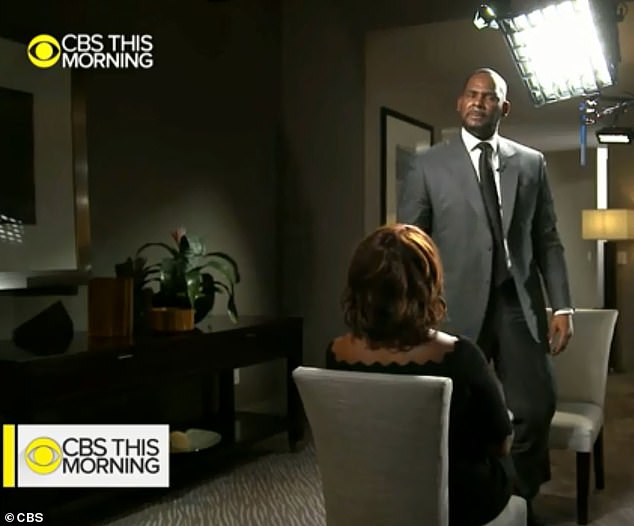 Kelly lost his composure elsewhere during the interview and stood up in a fit of emotion, towering over Gayle King