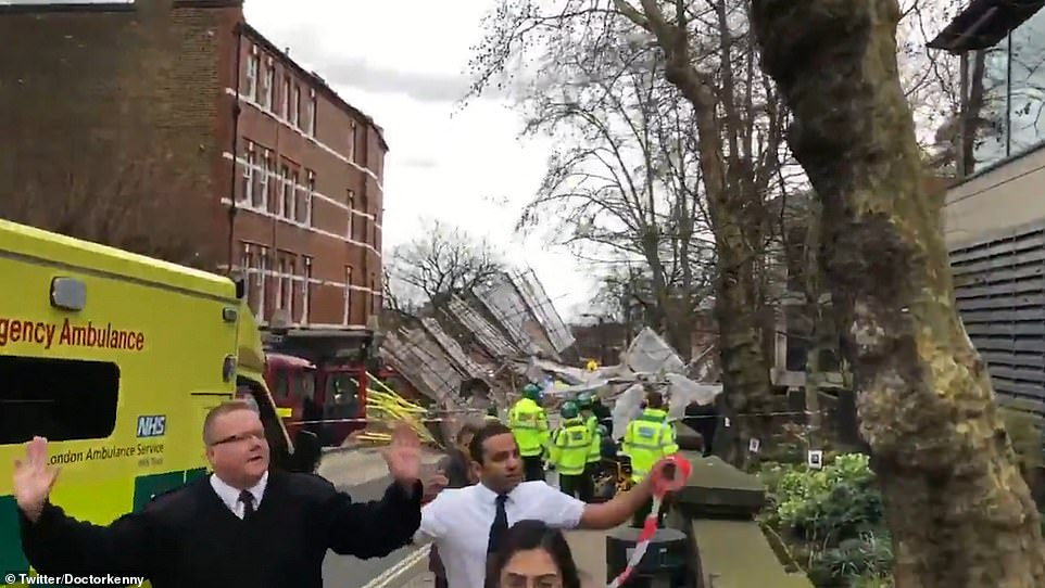In the footage, emergency services can be seen attending the incident and urging people to step back from the mass of collapsed scaffolding