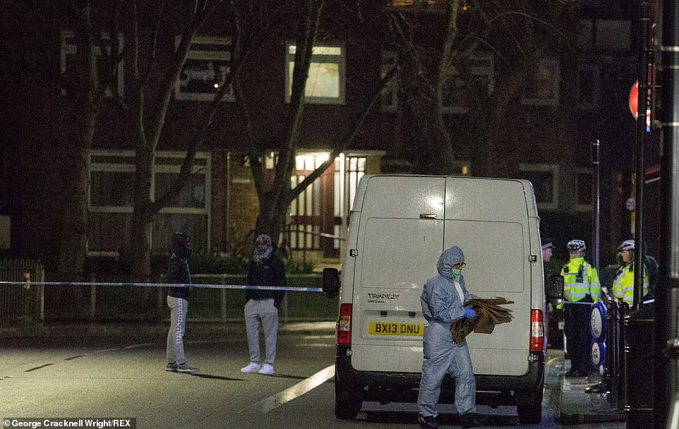 Forensic officers as the crime scene near a West London tube station yesterday evening