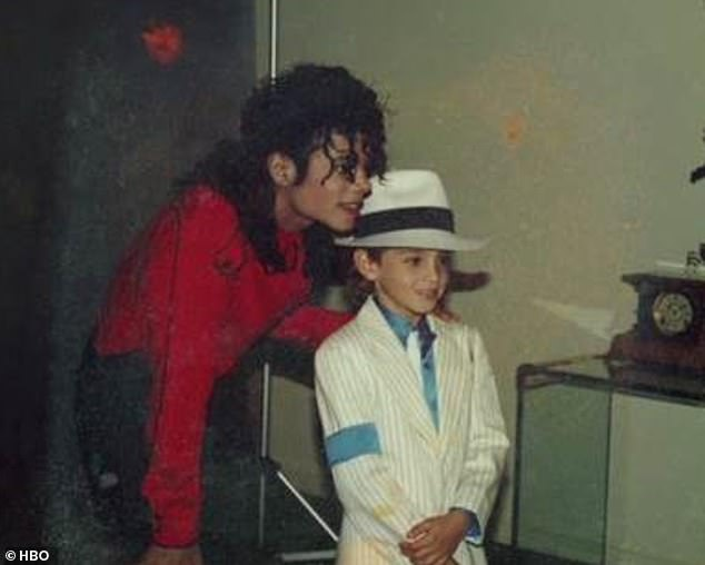 Abuse: Wade (pictured with Michael as a child) claims the singer abused him from aged nine