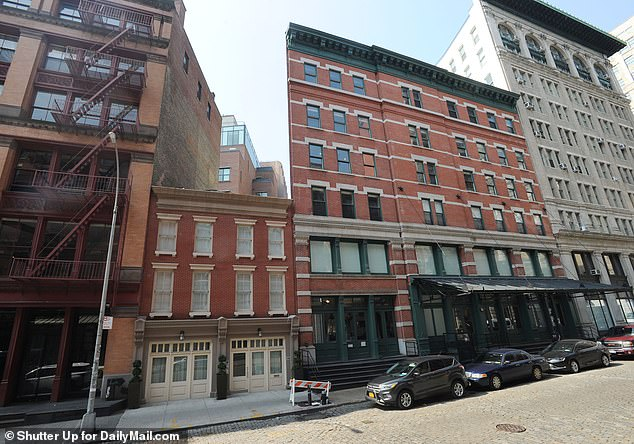 Alvarado used a ladder to climb onto the terrace of Swift's Tribeca townhouse (above) and smashed through a glass door with a concrete block before ransacking the home