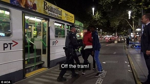 Dozens of teenagers were caught on camera charging onto a tram with police in hot pursuit