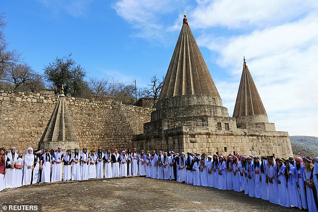 Yazidi women attend a ceremony at Lilash Temple on Friday to commemorate the deaths of thousands of women killed by ISIS militants during their reign of terror