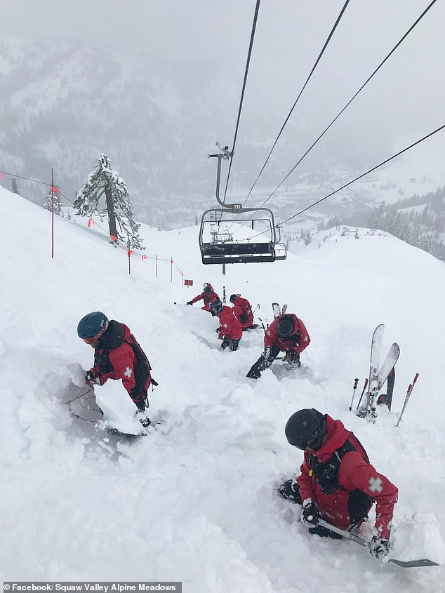 Workers are shown digging into snow as they make their way up Squaw Valley Alpine Meadows