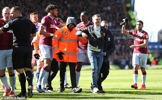 The 'fan' was eventually apprehended by stewards and players from both of the teams