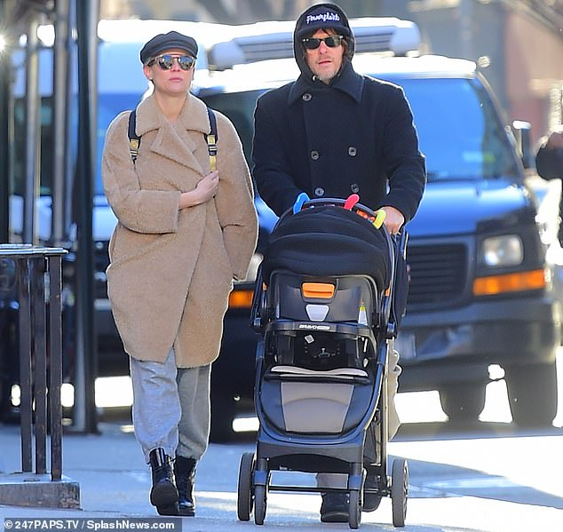 Family outing: Diane and Norman are shown in December taking their baby girl out for a stroll in New York City