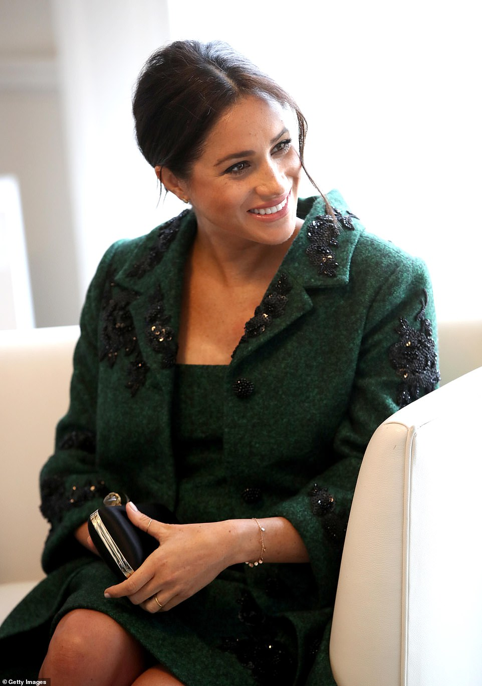 Meghan is all smiles as she joins Harry at a Commonwealth event this morning. In her message to mark the occasion, the Queen has praised how the 'family of nations' inspires its member states to find ways of protecting the planet and its citizens