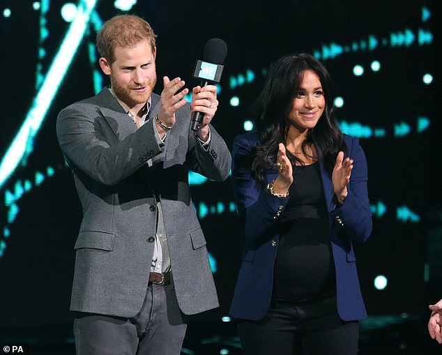 'Woke' new image: Harry and Meghan stand side-by-side as he gave WE charity speech to an audience of young people last week