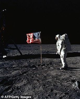 The file photo above, taken on July 20, 1969, shows astronaut Edwin E. Aldrin, Jr., lunar module pilot of the first lunar landing mission