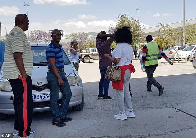 Family members arrive at Bole International airport in Addis Ababa, Ethiopia, after hearing news of the crash