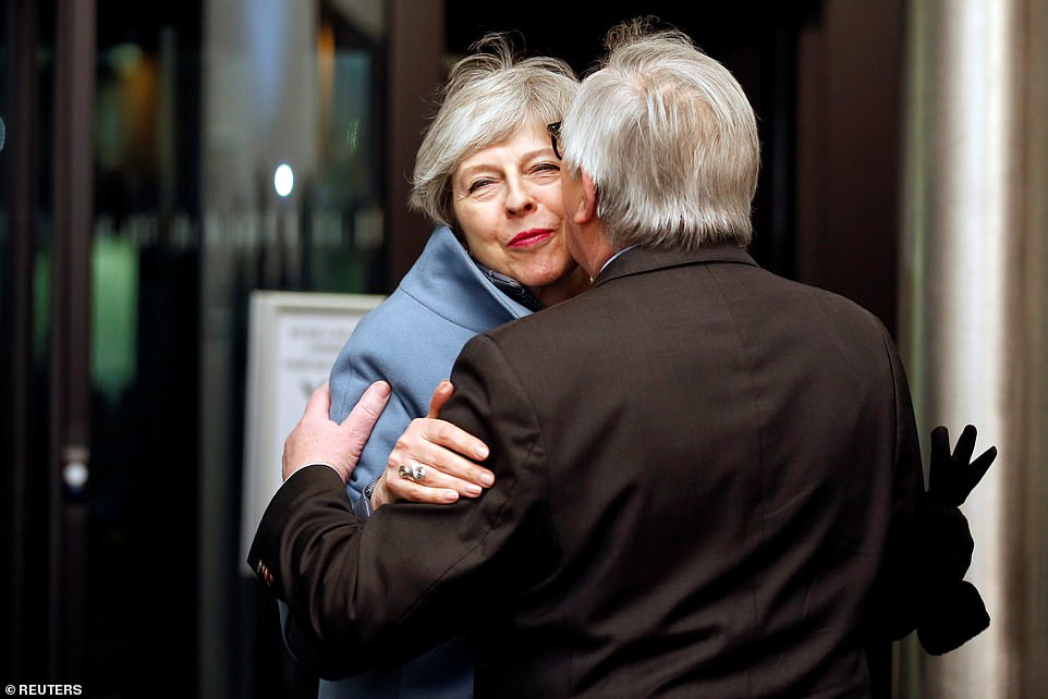 8.20pm - Mrs May brightens up as she is greeted by Jean-Claude Juncker alongside Michel Barnier at the European Parliament building in Strasbourg yesterday evening