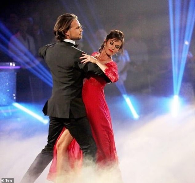 Gone: Cassandra was booted off DWTS on Monday (pictured with dance partner, Marco De Angelis)