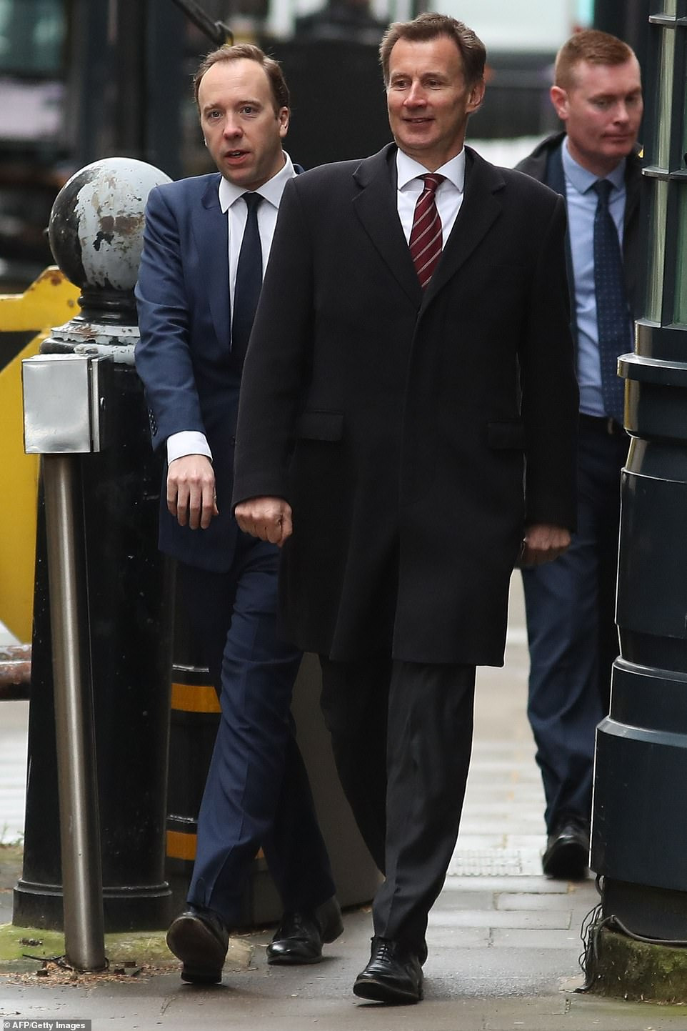 Health Secretary Matt Hancock and Jeremy Hunt arrive in Downing Street today ahead of the crucial vote tonight