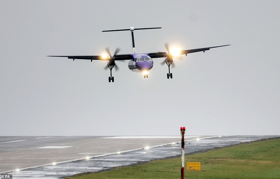 A plane lands in crosswinds at Leeds Bradford Airport in West Yorkshire ahead of Storm Gareth hitting Britain
