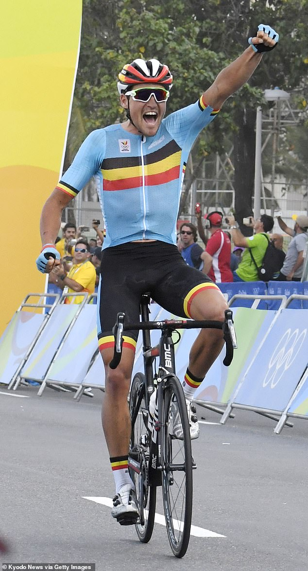 Belgium's Greg van Avermaet celebrates after winning the men's cycling road race gold on the first day of full competition at the Rio de Janeiro Olympics on Aug. 6, 2016. (Photo by Kyodo News via Getty Images)