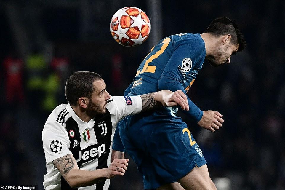 Atletico Madrid striker Alvaro Morata rises high to win the ball ahead of Juve's Italian centre-half Bonucci on Tuesday night