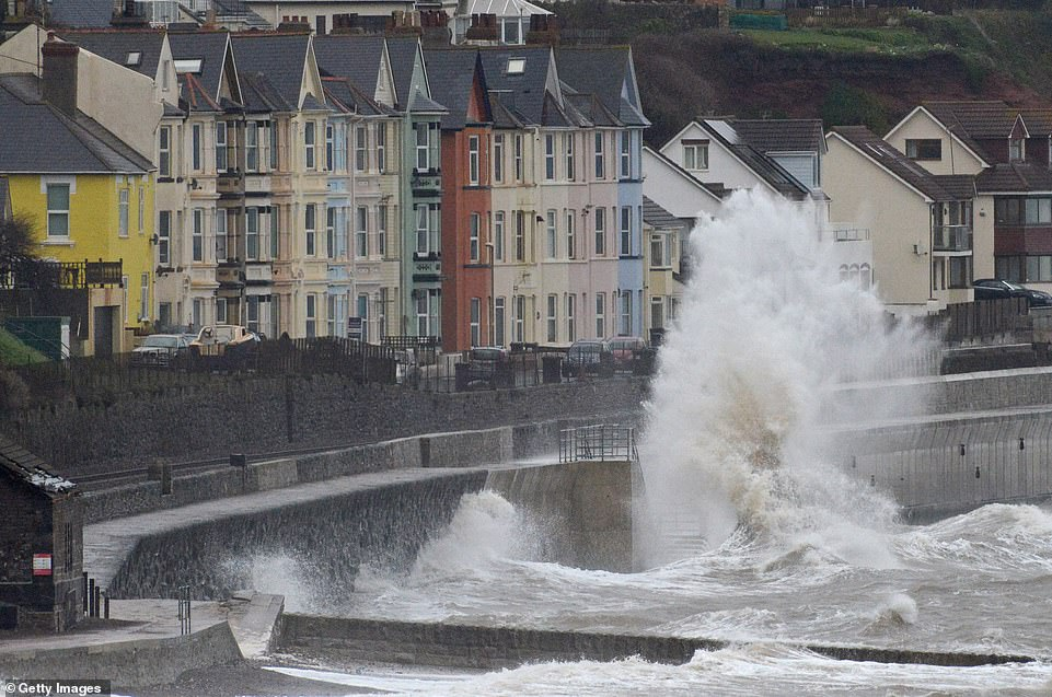 The main line through Dawlish in Devon was shut to some services on Tuesday as the storm sends huge waves crashing in