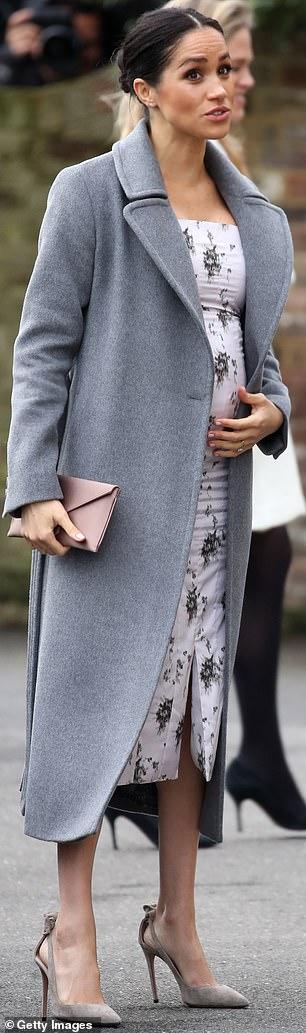 Chic grey: Aquazzurra £490 heels for a December charity visit
