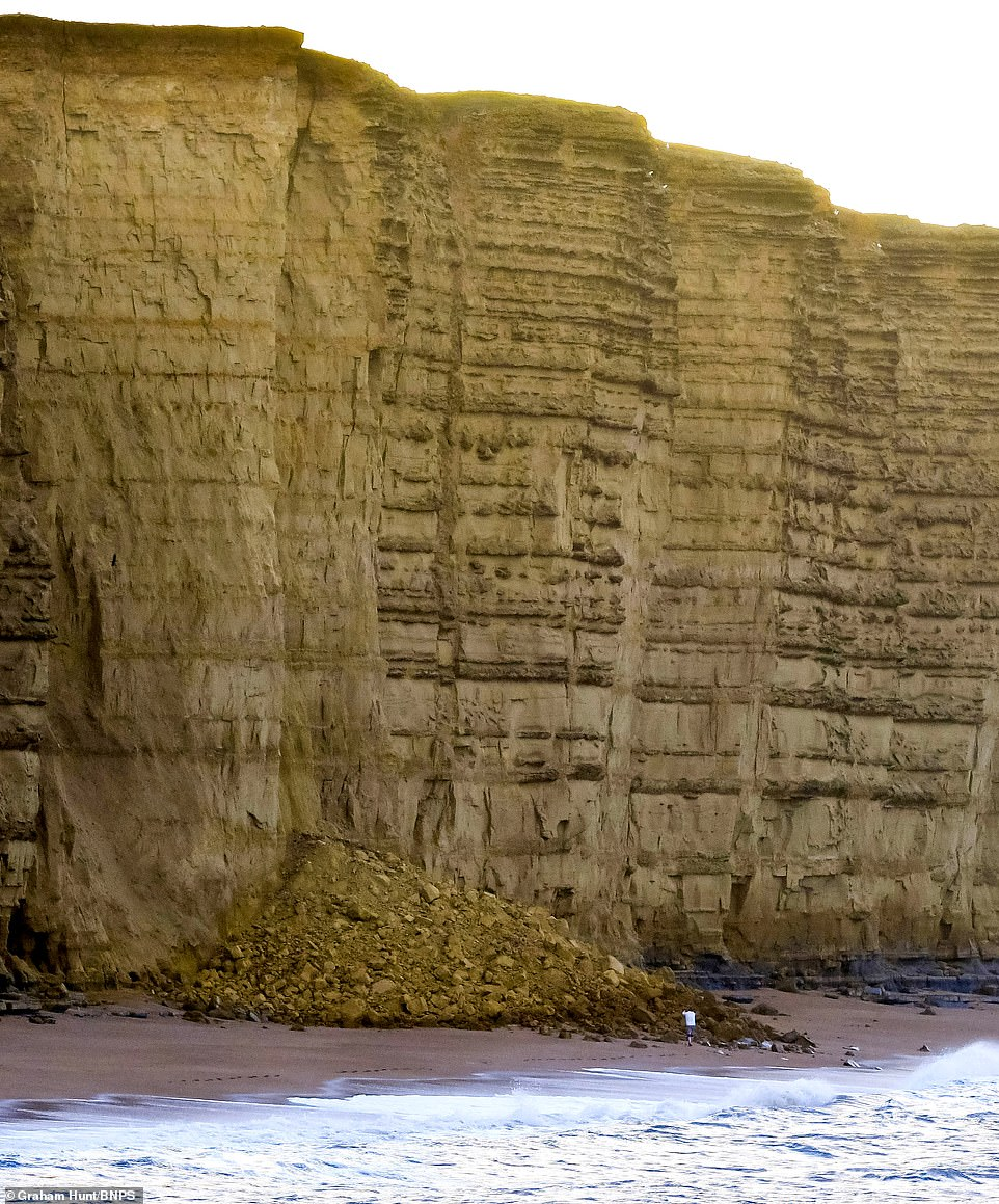 The cliffs at West Bay in Dorset are around 140ft high and the pile of rubble is around 30ft high after falling yesterday
