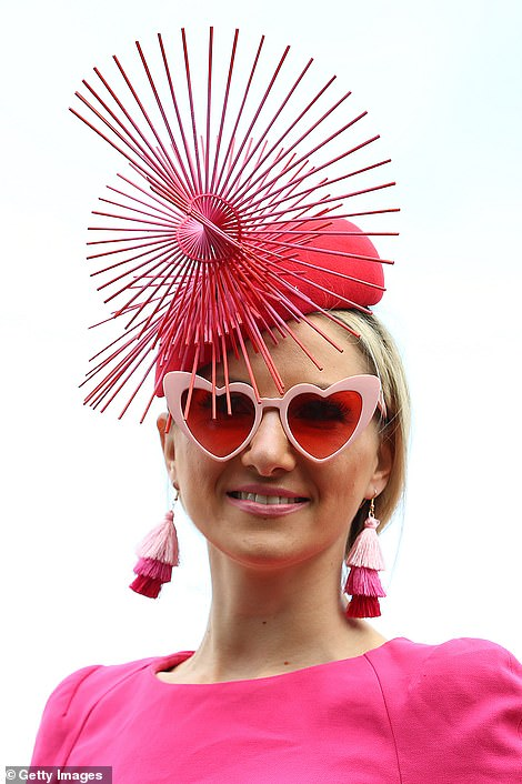 This filly went all out on accessories, teaming her distinctive hat with heart-shaped sunglasses and tassel earrings