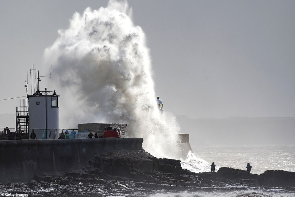Dramatic images from the coastline at Porthcawl in Wales show huge waves crashing against the sea wall today