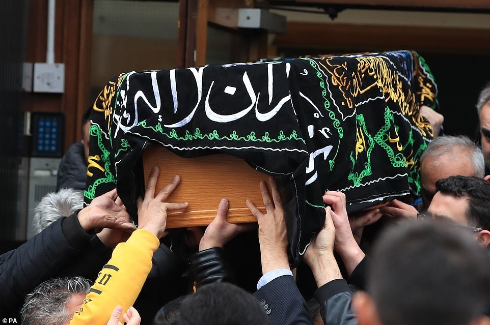 The teenager's body is carried into the Dar Al Hadi Foundation to join mourners for the packed funeral service