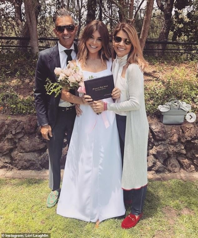 Education: Olivia started attending classes atat the University of Southern California last year. They are pictured following her high school graduation