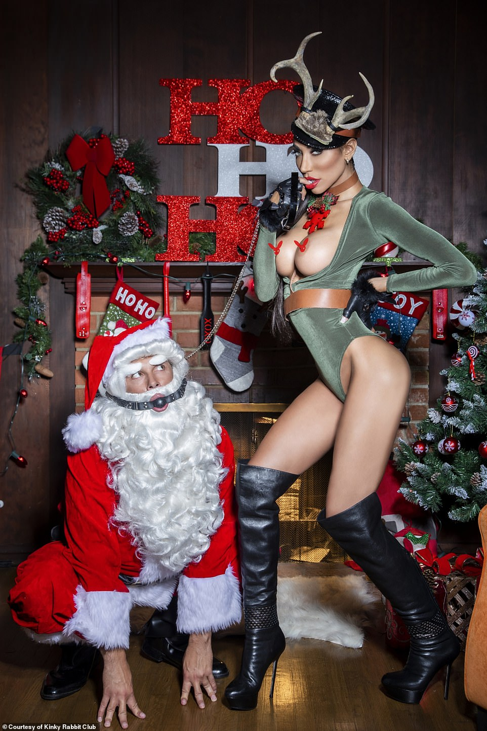 A naughty reindeer is pictured holding Santa Claus on a chain in this twisted world where guests are free to explore their darkest fantasies